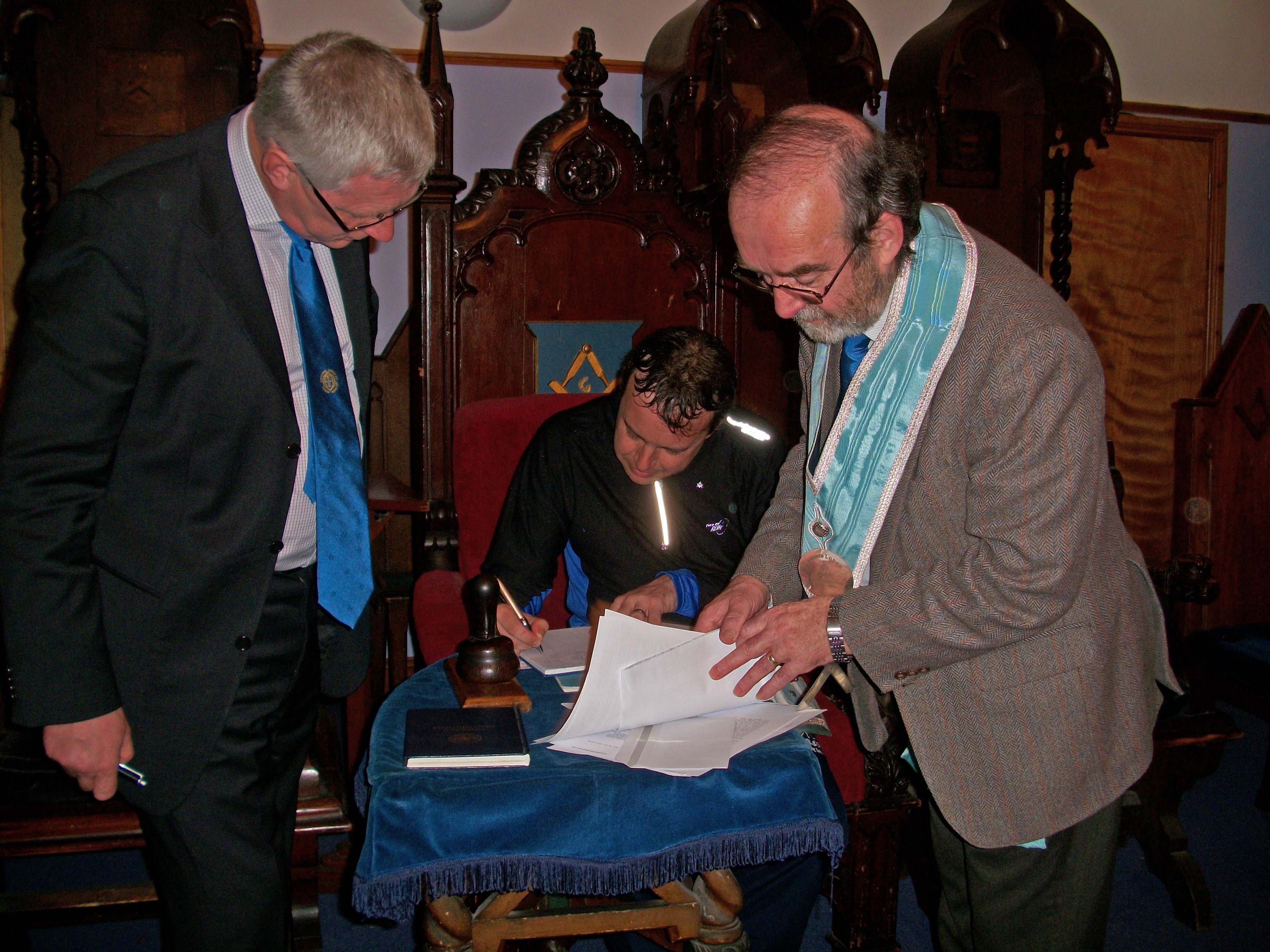 Signing the visitors' book